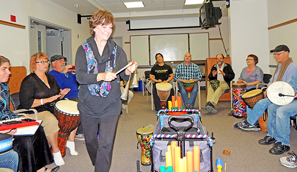 Susan Hall, leader of the La Mesa Drum Circle, shows how bellswebtop