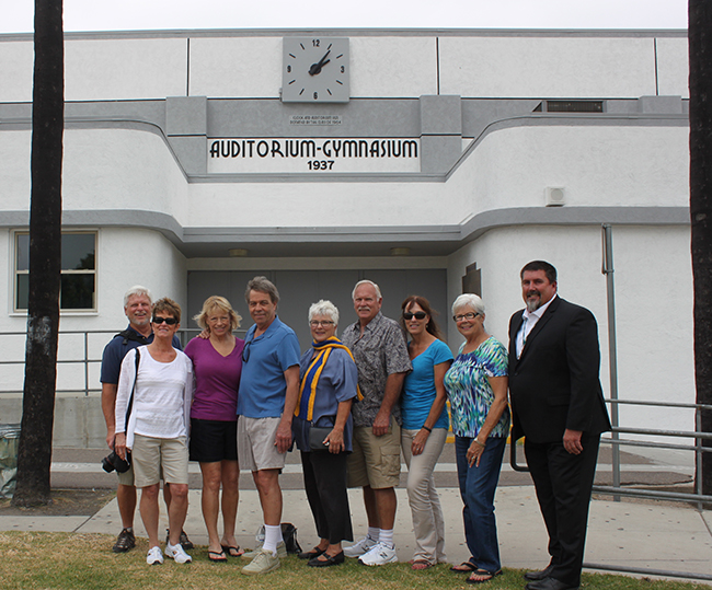 (l to r) Representing the Class of 1964, Ged Bulat, Cheryl Bulat, Llona Carlson, Bill Hoffman, Jody Catlin, Ron Shedd, Kathy Shedd and Carol Ambrosia pose with Principal Dan Barnes in front of the freshly repainted Old Gym (Courtesy GHS Museum)