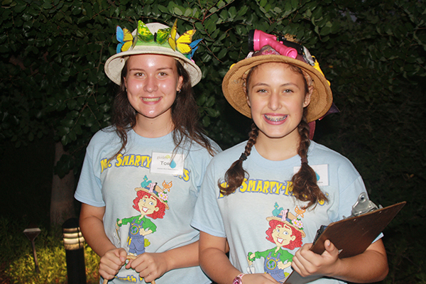 Junior Eco Ambassadors Tori Joynson (left) and Hanna Guzman sell raffle tickets at the Enchanted Garden Gala.