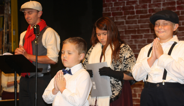 (l to r) Danny Deuprey as Bob Cratchit; Max Patag as Tiny Tim; AndreAna Canales as Martha; and James Patag as Peter Cratchit (Photo by Jeff Clemetson)