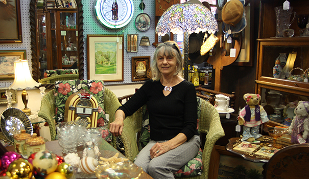 Antique Mall owner Marie McLaughlin sits among some of the many vintage items in her store. (Photo by Jeff Clemetson)
