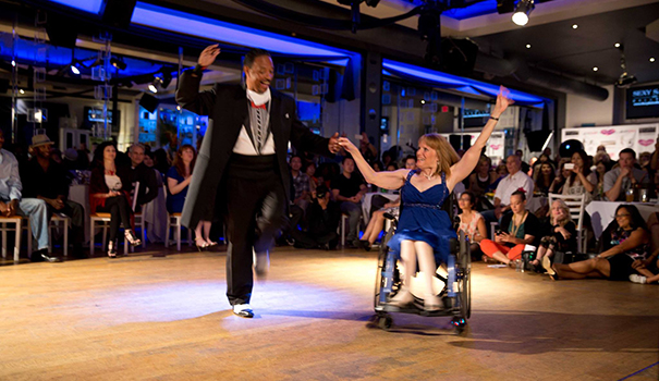 "Dance instructor Juan ""Joe"" Torres cuts a rug with wheelchair dancer Alisa Shuman. (Facebook)"