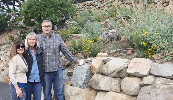 (l to r) Peggy Junker, Caroline Harrod and Ed Piffard stand in front of a garden of native plants at the parking entrance to Mt. Helix Park. (Photo by Jeff Clemetson)