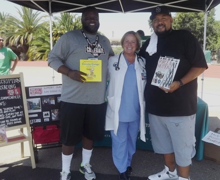 Local coaches George W. Jackson III and Lonnie Jones supporting reading with Dr. Irene Zink (SYHC).