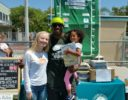 "Sarah Lackey ""Books for Friends"" with Reggie Bush and his Seuss fan daughter"