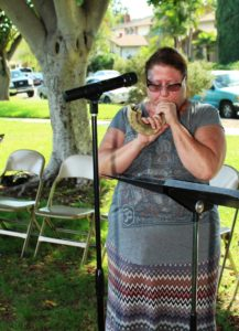 A woman blows a Shofar to begin the prayer service at last year's Day of Peace event. (Courtesy of St. Martin de Tours)